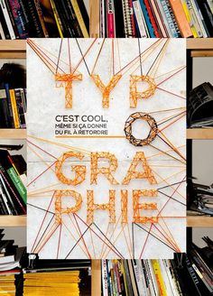 """Production of a poster on """"Typography is …"""". Made with wool and nails."""