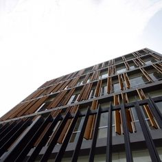 Architecture Photography: Office Building / Fernando Mosquera and Llona + Zamora Arquitectos - Philippine Consulate / Fernando Mosquera and #timber #facade #architecture #mechanized