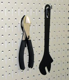 Wall Control Gray peg board metal tool board panel with black shadow board tool board tape to highlight tools