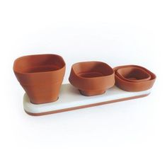 Grow a wide variety of herbs indoors with these height-adjustable planters.