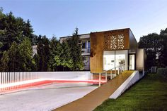 Perforated House Simple Cube with no Balconies house wooden plate facade #architecture #house #house design #dream home