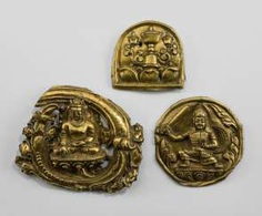 Three fire gilded relief plaques