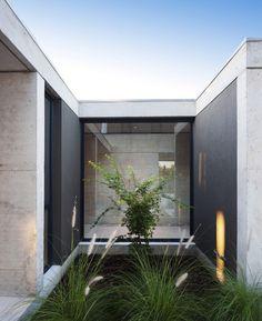 Casa E246 / Ezequiel Amado Cattaneo