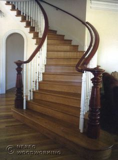Grand Victorian style staircase with wooden hand rails finished with scrolls, wooden treads and white painted banisters #victorian #staircas