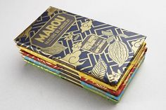 Marou chocolate packaging | Art and design inspiration from around the world - CreativeRoots #type #shield #pattern #gold