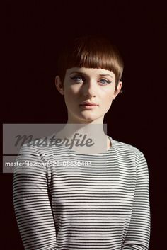Young Woman with Blunt Fringe and Black Eyeliner - Stock Photos : Masterfile