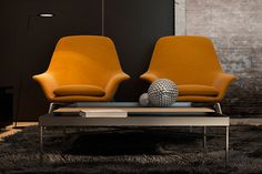 Orange Prince armchairs by Rodolfo Dordoni