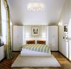 Minimalist bedroom with paintings