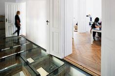 reiulf ramstad's oslo office features a transparent glass floor