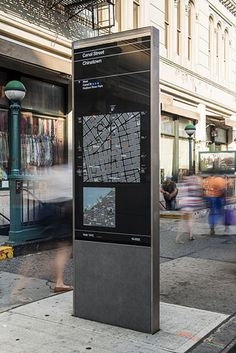 The kiosks present two maps, one of local streets and the other of the area\'s location in relation to a larger section of the city.