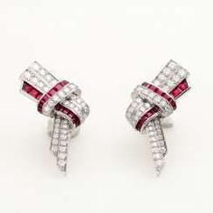 CARTIER Pair of loop earrings with precious stones