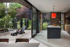 Helen House is a Simple Modern Structure Integrated with a Quiet Courtyard 5