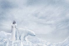 Woman and polar bear standing on glacier