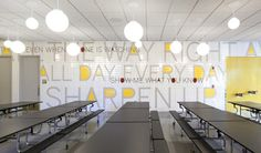 Paula Scher's supergraphics for the PAVE Academy Charter School in Brooklyn include a typographic tile mosaic in the school cafeteria. #environmental #design #graphic #typography