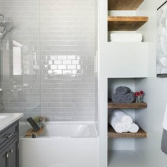 Example of a mid-sized danish 3/4 white tile and ceramic tile mosaic tile floor and multicolored floor bathroom design in Chicago with raised-panel cabinets, a two-piece toilet, white walls, a drop-in sink, soapstone countertops and gray cabinets