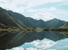 Once Wed - Designer Weddings for Less #zealand #green #clouds #water #grass #sky #mirror #blue #lake #symmetry #mountains #new