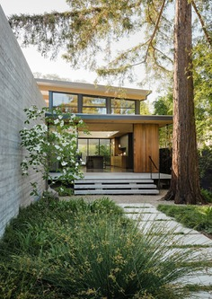 Modern home with Exterior, House Building Type, Wood Siding Material, and Concrete Siding Material.