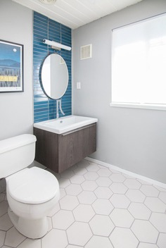 Bath Room, Wall Mount Sink, and Two Piece Toilet The renovated bathroom features tiles from Heath Ceramics. DIY All-Stars! A Family Rolls Up Their Sleeves and Restores an Eichler by Matthew Keeshin