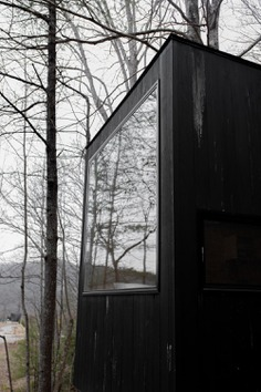 black wooden house with glass window