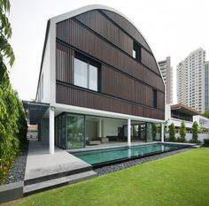 Modern Wind Vault House Displaying a Quirky Barn-Like Roof in Singapore #architecture #modern