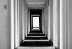 Zebra Corridor #urban #urbex #white #photo #door #exploring #corridor #black #photography #hotel #light