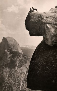 A man and his dog on the Overhanging Rock in Yosemite National Park, May 1924.Photograph by Educational-Bruce Photograph.jpg #white #yosemite #height #black #park #hang #cliff #photography #vintage #and #canyon #dog