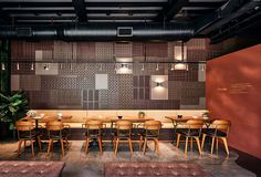 Clay Bricks Look Like Chocolate in a Restaurant Decor - InteriorZine #restaurant #decor #interior