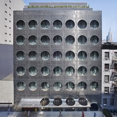 Dezeen architecture and design magazine #hotel #dots #facade #circles