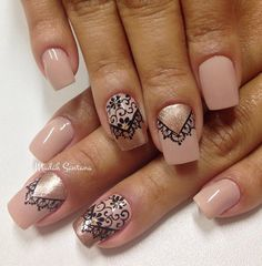 A beautiful nude nail art design with black polish and gold dust on top. Paint on intricate designs of laces on top and cap them off with so