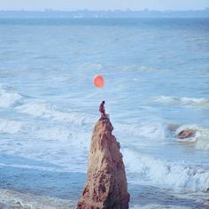 New Surreal Portraits from Oleg Oprisco #ocean #girl #cold #hair #balloon #photography #portrait #long #beach