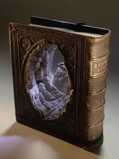 New Carved Book Landscapes by Guy Laramee | Colossal #laramee #book #sculptures #art #guy