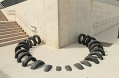 Visual street intervention in Barcelona #urban #visual #iago #geometry #installation #tire #black #mateu #serra #octavi #art #street #ooss