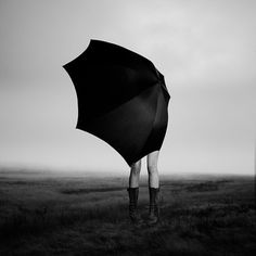 Girl with Umbrella 27x27 Framed Matted Behind by eddieobryanphoto