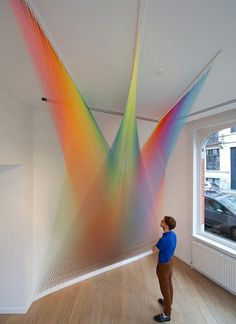Unique like rainbow textile art in white interior installation #exhibition #textile #art #installation