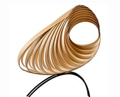 This curvy chair that will enhance the look of your room with its harmonic aesthetic and sculptured body. The Yumi is a truly unique stateme #product #design #modern