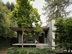 Modern home with Outdoor, Shrubs, Small Patio, Porch, Deck, Concrete Patio, Porch, Deck, Grass, Back Yard, Wood Fences, Wall, Trees, and Hardscapes. Photo 5 of The Sanctuary