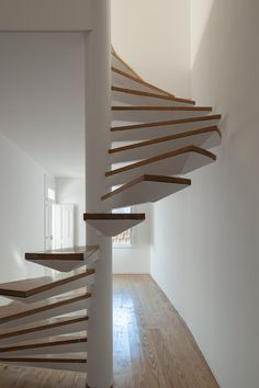 Two Houses in Largo do Trovador by Pitagoras Group. #pitagorasgroup #minimalism #spiralstaircase #staircase