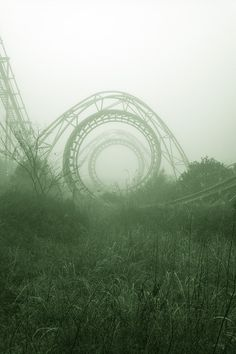 Image Spark - Image tagged #rollercoaster #fog #sky #grass #photo #mystery #circle #horizon