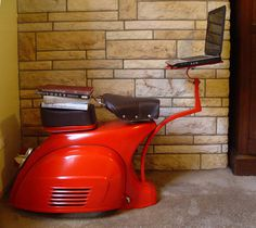 Designer David Giammetta rescued this 1968 Vespa Sprint and turned it into this awesome work station. #vespa #design #station #work