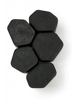 Black wooden table emulating volcanic basalt. #wood #furniture #table #black