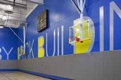 The 7 ft high letters wrap around the walls of the gym. #environmental #design #graphic #typography