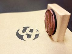 Dribbble - Usman Group Stamp by Usman Group #stamp #ink #branding #moleskin #print #logo #paper #typography