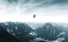 Hot air balloon floating over Hallstatt in the Austrian Alps Photo by: www.mateiplesa.com #balloon #floating #hotair #mountains #lake #maj