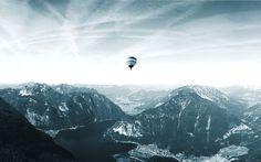 Hot air balloon floating over Hallstatt in the Austrian Alps  Photo by: www.mateiplesa.com  #balloon #floating #hotair #mountains #lake #maj