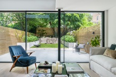 """""""My favorite part of the project are the big glass doors and the skylights. The space honestly has been transformed. We now see the full width of our garden and it feels like it's part of our living space,"""" says Olivia."""