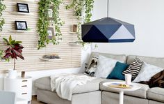 IKEA MANDAL wooden headbed on wall, plants and JOXTORP geometric pendant lampshade in living room