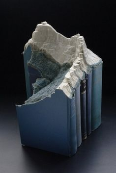 Carved Book Landscapes by Guy Laramee | Colossal #mountain #sculpture #pages #book #landscape #paper