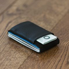 This wallet holds your cards, bills, and coins in a minimalist fashion.