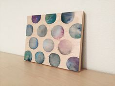 Watercolor circle painting on wood panel