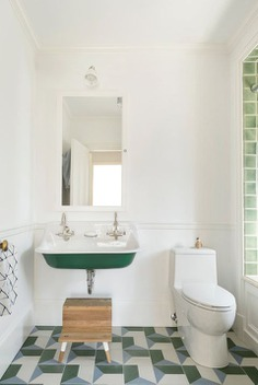bathroom with green tiles and sink